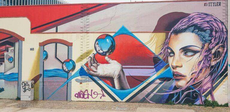 street art sur les quais de Lisbonne artiste styler