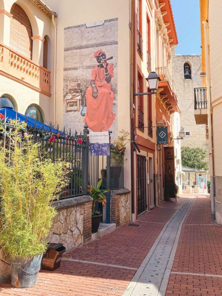 peinture femme cubaine cigar mur begur orange espagne catalogne
